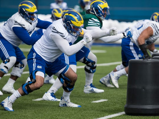 The Delaware defensive line run through drills during