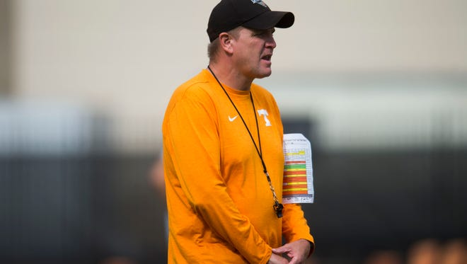 Tennessee defensive coordinator Bob Shoop walks on the field during University of Tennessee fall football practice at Anderson Training Facility in Knoxville, Tenn. on Tuesday, Sept. 12, 2017.