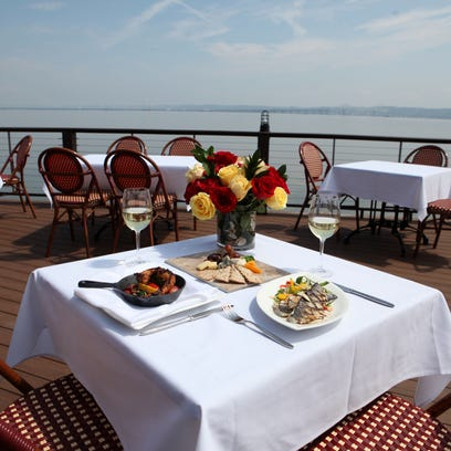 The outdoor patio at Pier 701 boasts Hudson River and