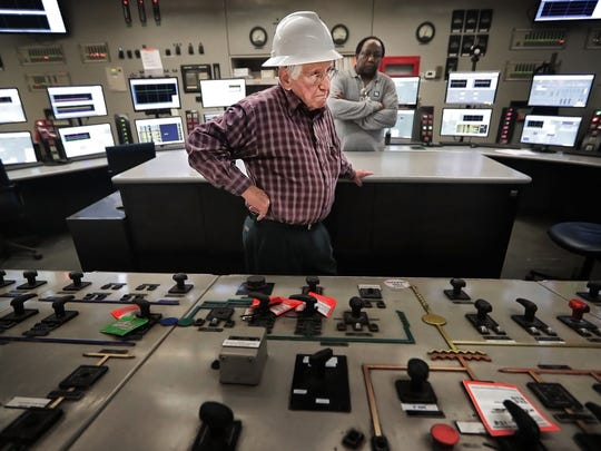 A.C. Cox, 85, talks about some of the changes in technology he saw at the Allen Fossil Plant as he stands over the control panel he used to officially shut down the plant a few weeks ago. Cox began working at the plant just after its completion in 1959. The plant  was taken offline as TVA prepares to begin operating the $975 million Allen Combined Cycle Plant barely a quarter-mile to the south on Riverport Road.