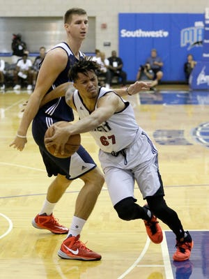 Miami Heat's Damion Lee (67) draws a foul as he gets tangled up with Oklahoma City Thunder's Tomislav Zubcic (40) during the second half of an NBA summer league basketball game, Friday, July 8, 2016, in Orlando, Fla. (AP Photo/John Raoux)