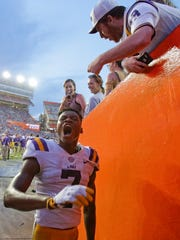 LSU wide receiver D.J. Chark celebrates as he leaves