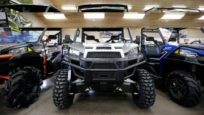 This Dec. 16, 2015 photo shows all-terrain vehicles at a dealership in Algona, Iowa. The buzzy, open-air vehicles are supposed to be banned from roads in New York and other states. But small communities across the nation are increasingly bending the rules under pressure from riders who want to go wherever they please, even though ATV manufacturers warn that the vehicles are unstable on flat pavement and accidents kill more than 300 riders each year. (AP Photo/Charlie Neibergall)