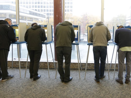 People line the voting booths at the Frank P. Zeidler Municipal Building on North Broadway in Milwaukee.