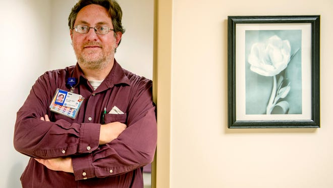 Ed Betzelberger, a licensed clinical social worker for UnityPoint Health Unity Place, poses for a photo in his East Peoria office Monday, Oct. 19, 2020. Betzelberger says that the pandemic will likely exacerbate the emotional issues associated with the onset of winter and seasonal affective disorder.
