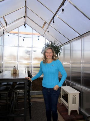 Rachel Heise, general manger of the Great Revivalist Brew Lab, is shown in one of the six heated greenhouses available for outdoor dining during the winter months. Photo by Claudia Loucks