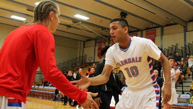 Glendale junior Monty Johal (right) entered Tuesday's game at West Plains needing 13 points to set the Glendale High School career scoring record.