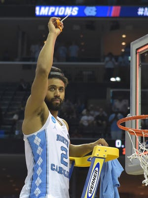 North Carolina Tar Heels guard Joel Berry II (2) helps to cut the nets after defeating the Kentucky Wildcats in the finals of the South Regional of the 2017 NCAA Tournament at FedExForum.