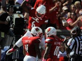 Louisville's Russ Yeast (6) and Jaire Alexander (10) celebrate an interception in the endzone by TreSean Smith (4) against Boston College on Saturday at Papa John's Cardinal Stadium. Oct. 14, 2017