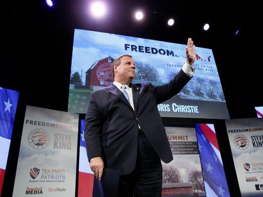 New Jersey Gov. Chris Christie waves after speaking