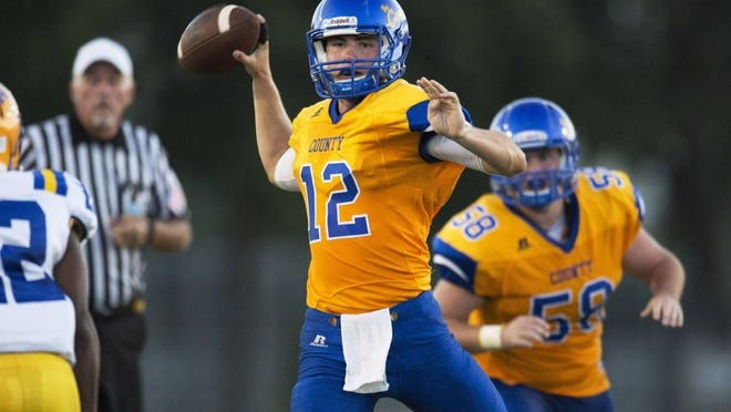 Martin County's quarterback Austin Kuyrkendall (12), shown in a game against Auburndale at Martin County High School in Stuart earlier this season, will lead the Tigers against Viera Friday night. (HOBIE HILER/ SPECIAL TO TREASURE COAST NEWSPAPERS)