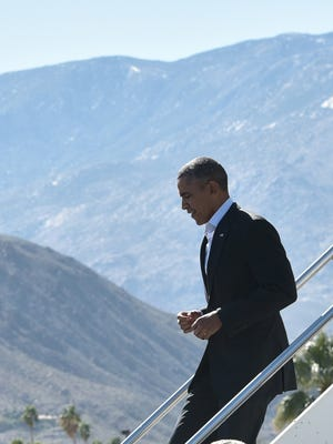 President Barack Obama steps off Air Force One upon arrival at Palm Springs International Airport in Palm Springs, California on February 12, 2016.