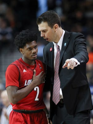 U of L head coach David Padgett gives instruction to Darius Perry (2) after removing him from the game against Virginia during the ACC Tournament in Brooklyn, NY.    