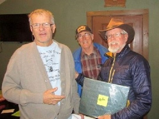 Tony Davis, right, and Dick Mastin from the White Mountain Search and Rescue presented a custom gift to Mike Bilbo at left.