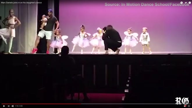 """The Internet has fallen in love with the dad who jumped on stage to help his daughter complete her recital performance after she was struck with stage fright. His new title is """"Daderina."""""""