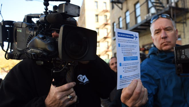 News media take video of Ebola information outside an apartment building in New York. A 5-year-old boy, who lives in the building who recently returned to New York City from the West African nation of Guinea, is being tested for Ebola after he was rushed to the hospital Monday with symptoms consistent with the disease, according to health officials.