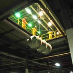 Equipment that formerly was used in uranium enrichment at the Portsmouth Gaseous Diffusion Plant is lowered from the upper floor of the X-326 Process Building during site cleanup operations.