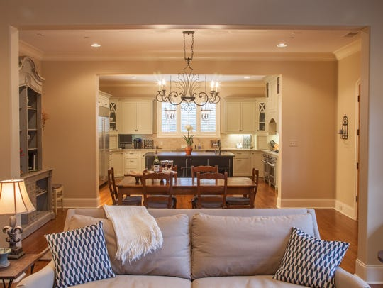 Open concept design. View from living room into dining
