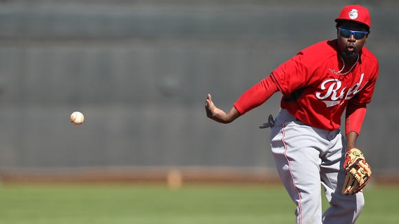 Reds second baseman Brandon Phillips with a no-look flip to second base during fielding drills.