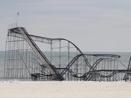 The wreckage of the Jet Star Roller Coaster rests in the surf on May 13, 2013, in Seaside Heights, N.J.