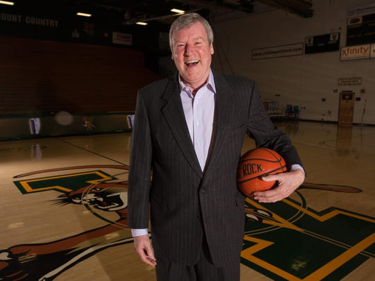 Tom Brennan, the former University of Vermont men's basketball coach, poses for a portrait last year.