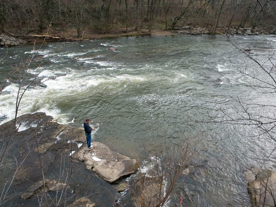 A man fishes in the Brandywine near the Brandwine Filter Plant in Wilmington on Wednesday.