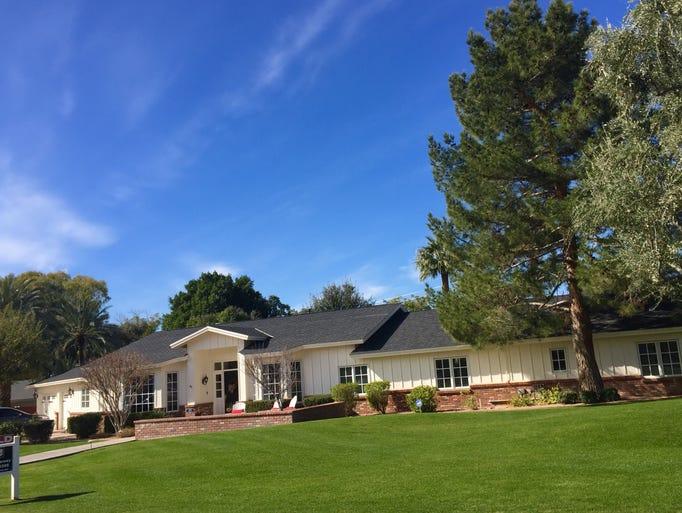 John R. Dawson bought a $1.8 million, 1959 house in