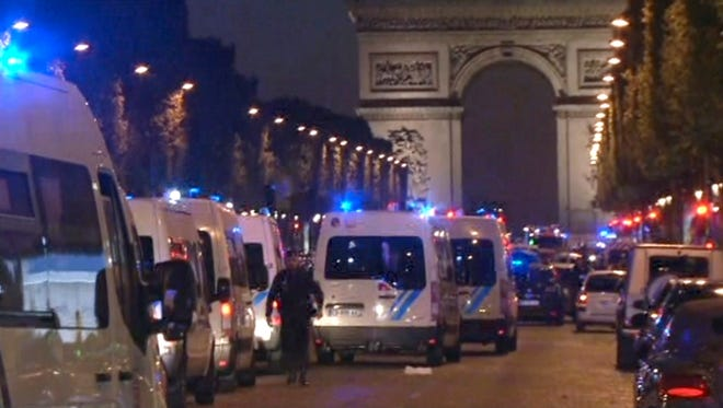 In this image made from video, police attend the scene after an incident on the Champs-Elysees in Paris on April 20, 2017.