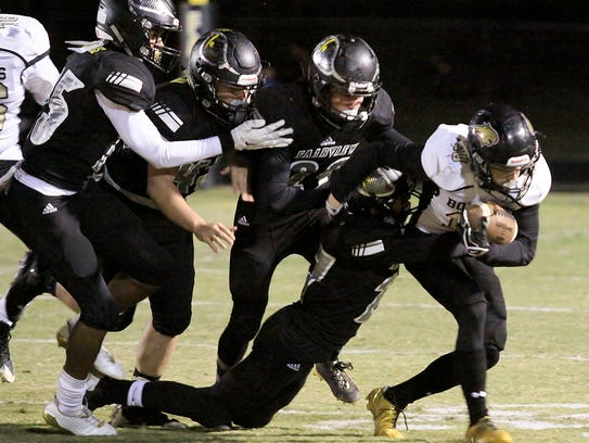 The Yellow Jacket defense work together to stop a Giles