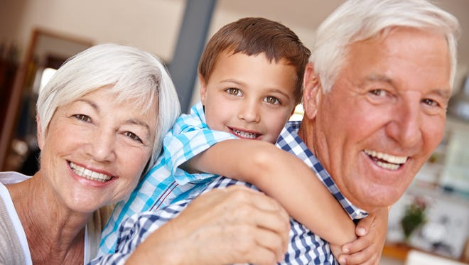 A young boy with his grandparents.