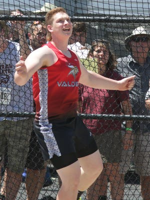 Valders' Christopher Evenson watches his discus throw at the state track and field meet in La Crosse on Friday.