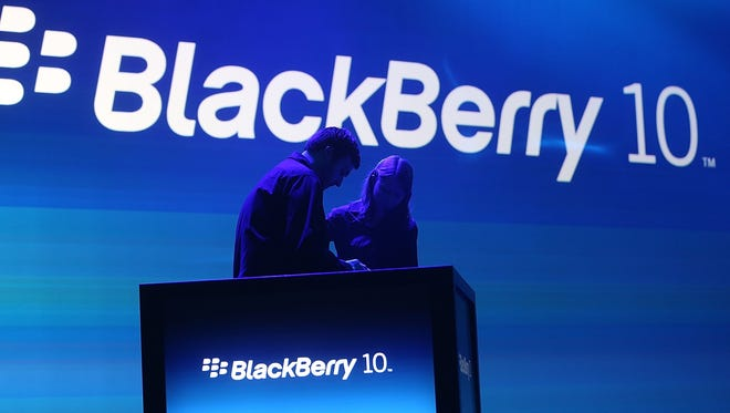 Workers prepare the podium before the start of the BlackBerry 10 launch event by Research in Motion at Pier 36 in Manhattan on Jan. 30.