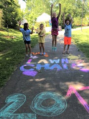 Kids made a chalk design and burned off a little energy during last month's concert.