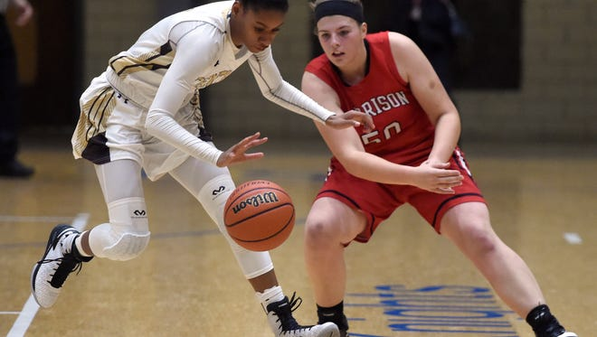Errin Hodges of Central comes up with the loose ball ahead of Britney Young of Harrison during the second quarter of the SIAC girlsÕ basketball tournament at Castle High School Friday.