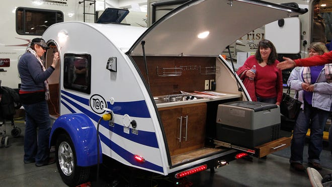 Visitors to the Milwaukee RV Show check out the T@G Teardrop Trailer in this 2014 file photo. More than 100 exhibitors will be at State Fair Park for this year's show March 1-4, which will feature the latest in pop-up campers, truck campers, travel trailers, fifth wheels, motor homes and park models.