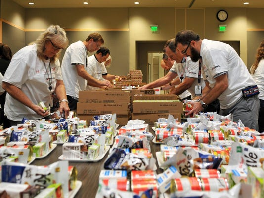 Harris Corp packs meals for Childrens Hunger Project