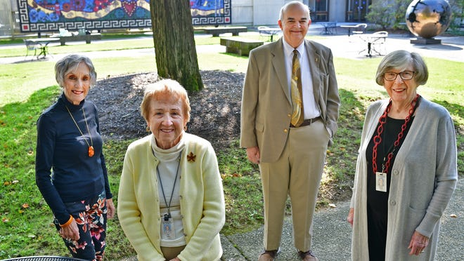 Docents from Worcester Art Museum include, from left, Arlene Pedjoe, Pat Dupre, Paul Mahon and Carole Harmon. They're pictured in the museum courtyard Sept. 21.