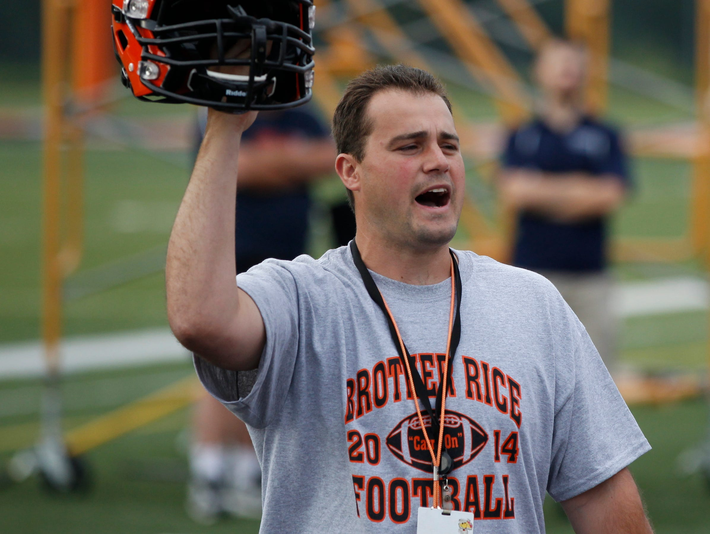 Birmingham Brother Rice football coach Dave Sofran works at practice Aug. 11, 2014.