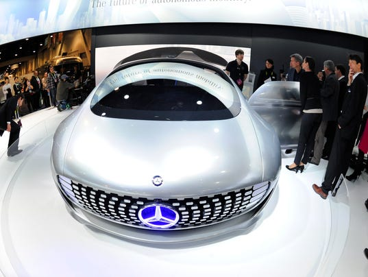 People inspect the Mercedes-Benz F015 Luxury in Motion vehicle on Jan ...