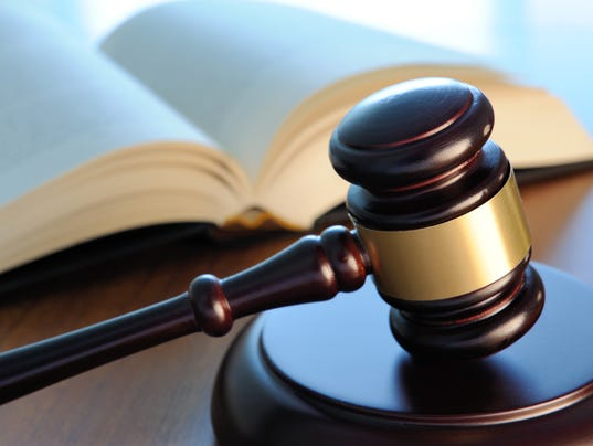 Gavel and book on a table