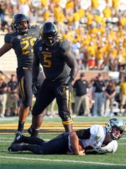 Missouri defensive lineman Terry Beckner Jr. (5) celebrates after sacking Purdue quarterback David Blough in the second half of the Boilermakers' victory in 2017.