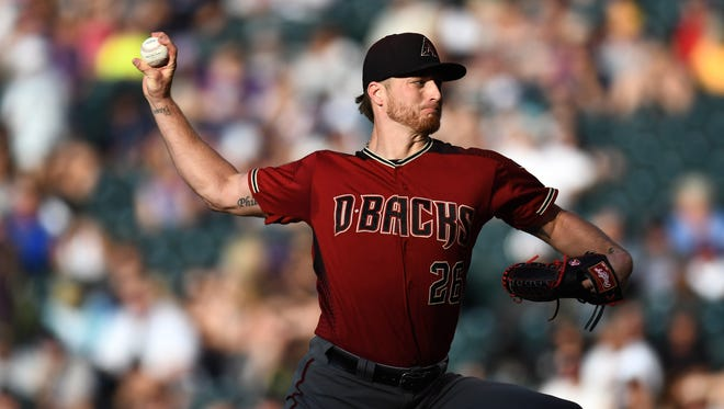 Jul 11, 2018: Arizona Diamondbacks starting pitcher Shelby Miller (26) delivers a pitch in the first inning against the Colorado Rockies at Coors Field.