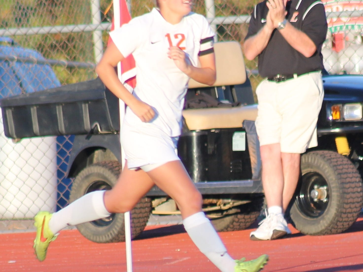 Loveland senior Haleigh Goedde runs on the field for the Lady Tigers in a September game against Walnut Hills. Goedde will continue her soccer career at Tiffin.