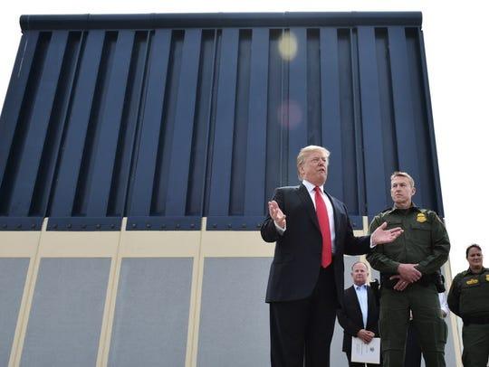 President Trump speaks during an inspection of border