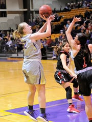 Hardin-Simmons Heidi Schroeder (52) puts up a shot over a Sul Ross State defender during the Cowgirls' 83-55 win on Thursday, Feb. 8, 2018 at the Mabee Complex.