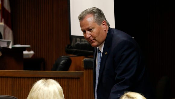 Alabama House Speaker Mike Hubbard talks to his wife