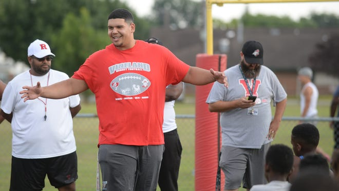 Jamil Demby, Vineland graduate and Los Angeles Rams offensive tackle, gives the participates of the Vineland Midget Football League Camp a pep talk before drills on Wednesday. 07.18.18