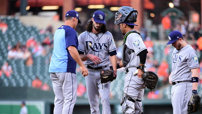 Rays pitcher Hunter Wood is removed from the game by manager Kevin Cash.