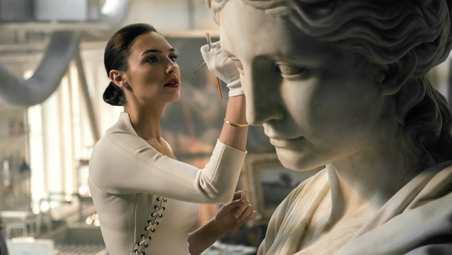 """In """"Justice League,"""" Wonder Woman (Gal Gadot) moonlights as Diana Prince — or is it the other way around?"""