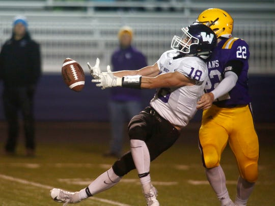 Waukee senior Zach Eaton tries to bring in a pass while